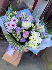 Lilac and cream dream bouquet. Lilac lisianthus, cream roses and chrysanthemums. Boxed bouquet in water